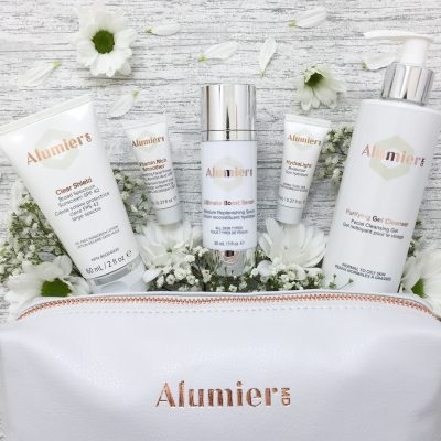 Various AlumierMD skin care products for a radiant after glow